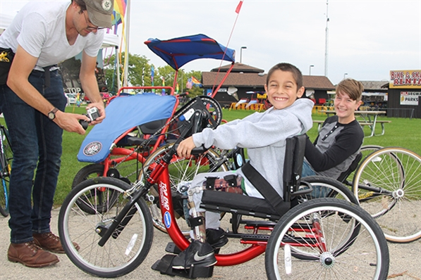 Youth riding handcycle
