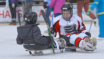 Sledges, or ice-sleds, make skating accessible at Slice of Ice in Red Arrow Park