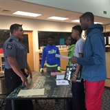 Explorer Robby Ellifson recruiting at Roosevelt Middle School