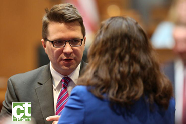 Rep. Evan Goyke of Milwaukee speaking with a woman