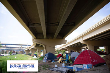 Tent camp beneath interstate overpass