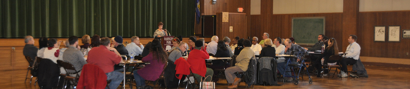 Public at an event at Washington Park Senior Center