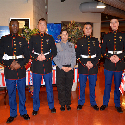 Explorer standing with  Military Personnel